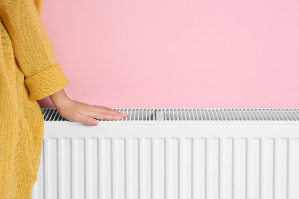 hand on the top of a radiator